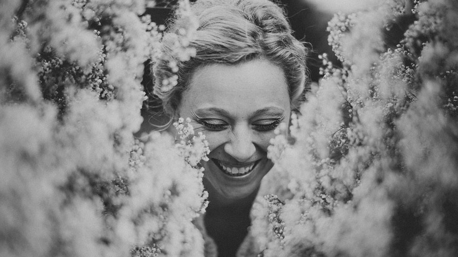 candid black and white portrait of a bride laughing