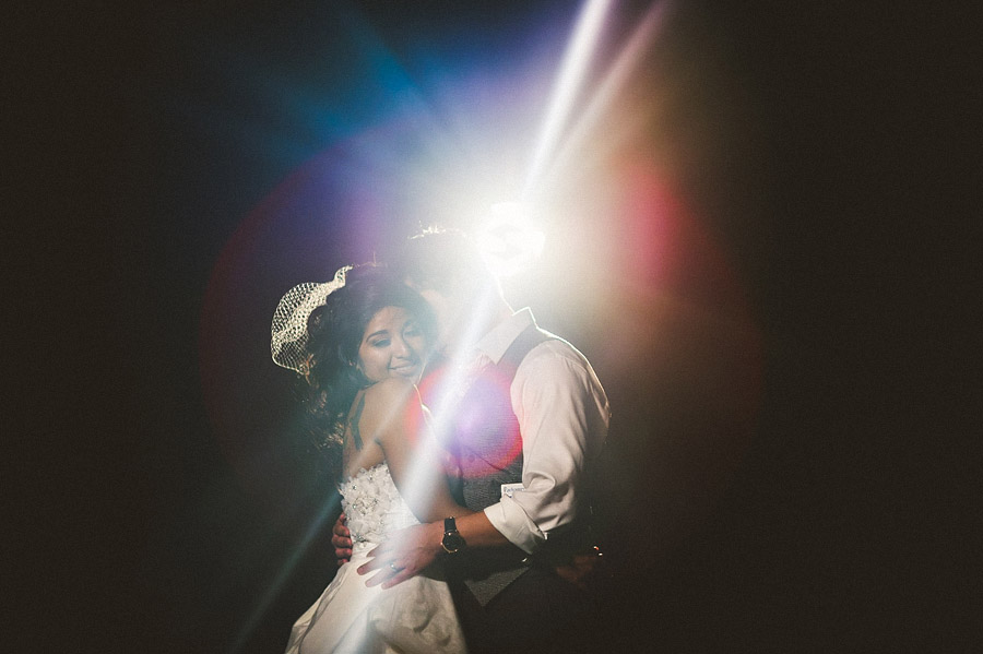 artistic photo at night of a wedding at blue mount vineyard in virginia