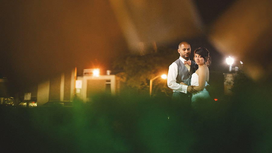 artistic portrait of bride and groom at night time