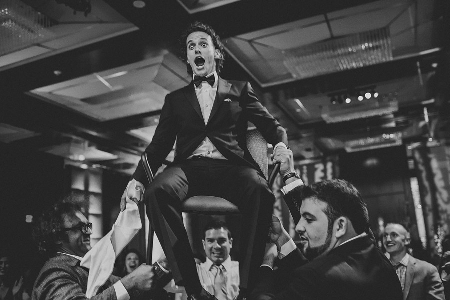 black and white groom reception in chair