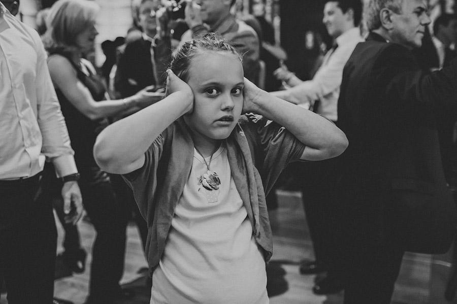 girl hiding ears