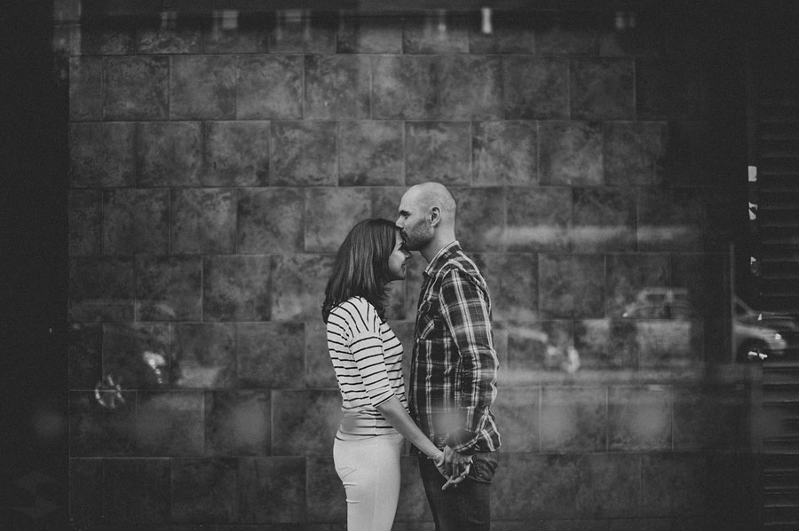black and white of man and woman kissing