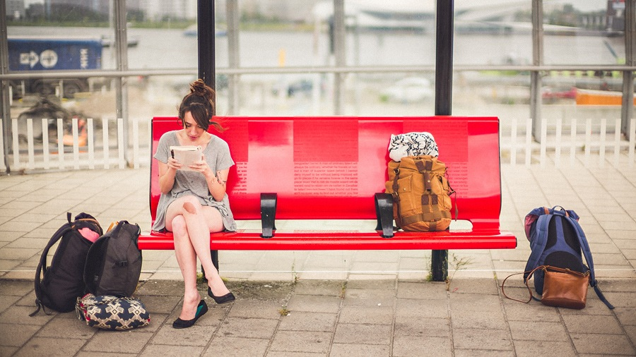person waiting on train station bench