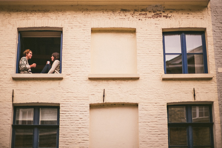 people sitting in window