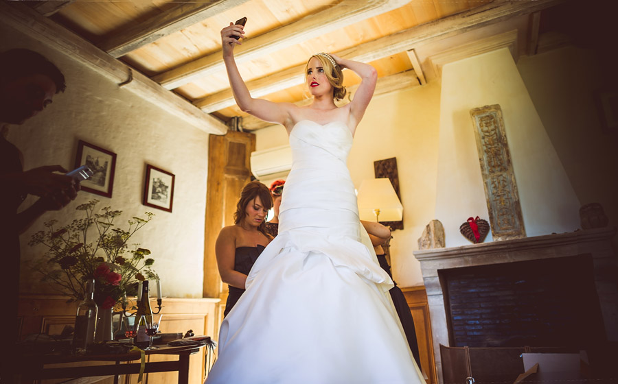 bride checking hair before getting married