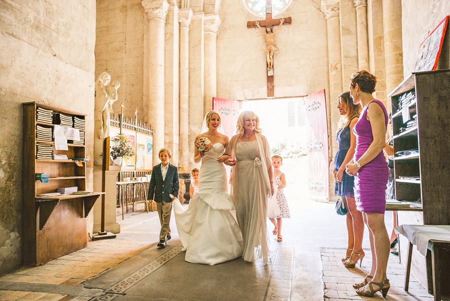 bride walking down aisle with her mother