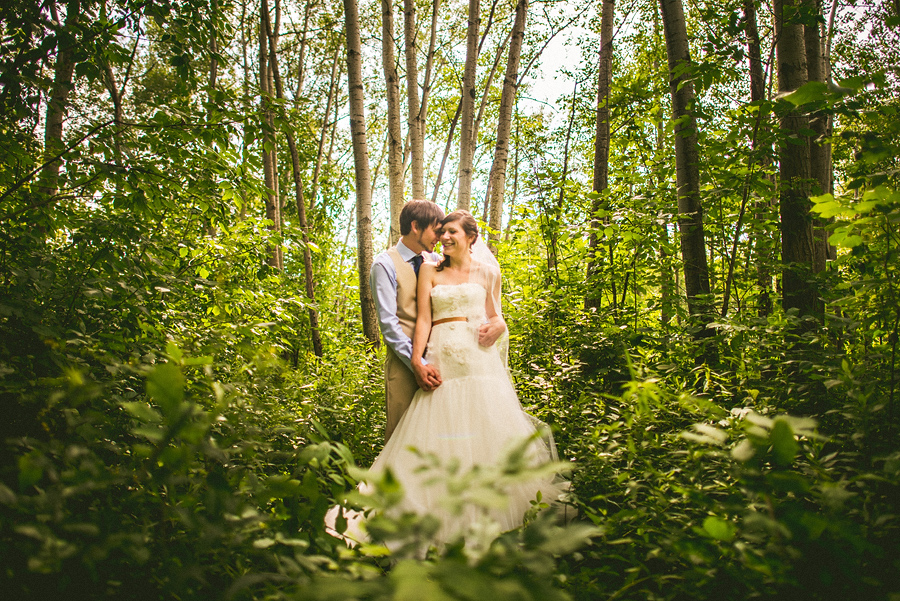 portrait of bride and groom in woods