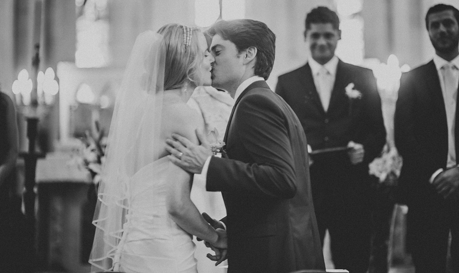 bride and groom first kiss catholic wedding in france