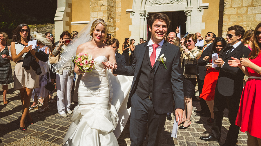 bride and groom exiting church in french wedding