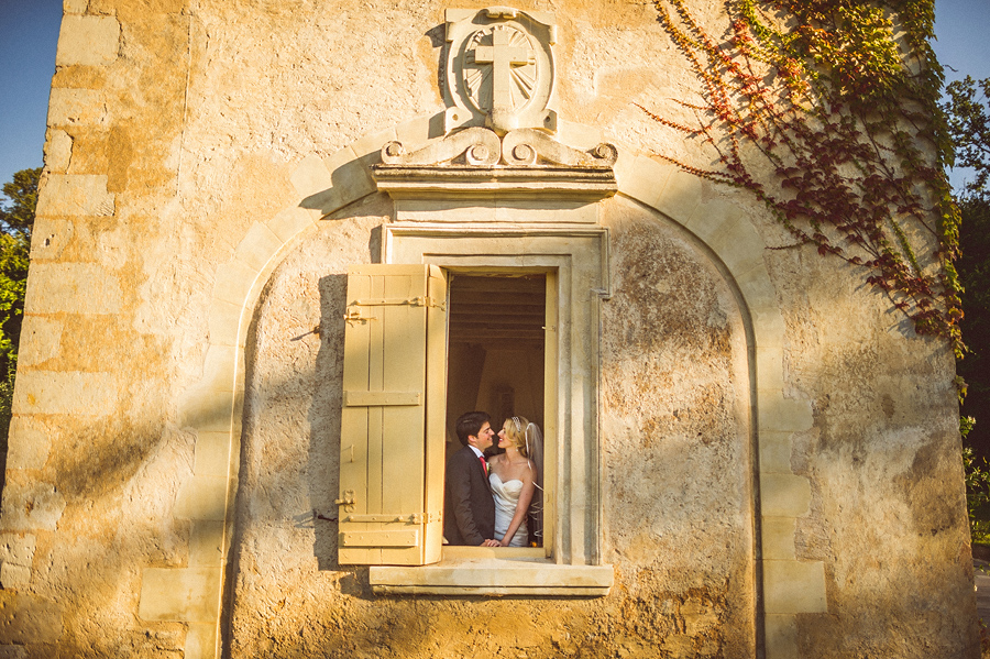 creative bride and groom portrait on french wedding venue