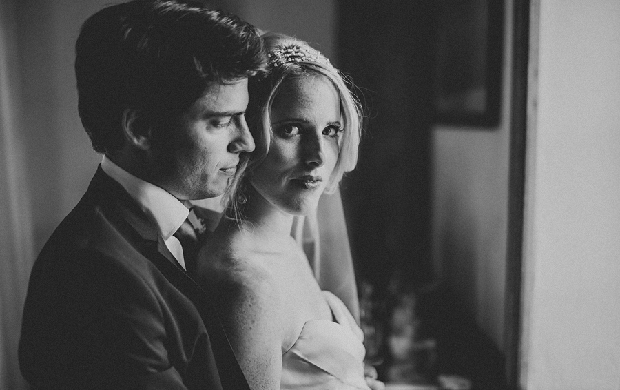 dramatic black and white photo of bride and groom