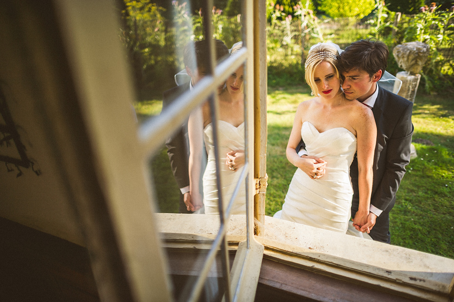 cool window reflection of bride and groom
