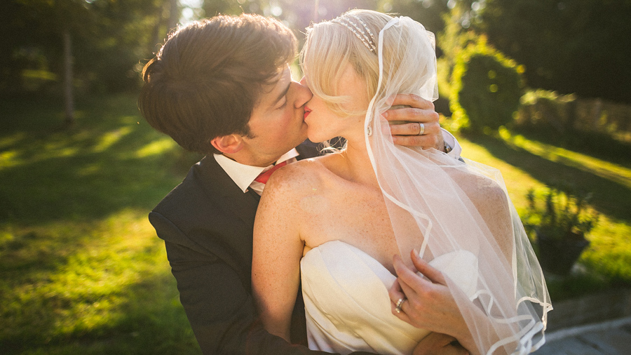bride and groom kissing intensly