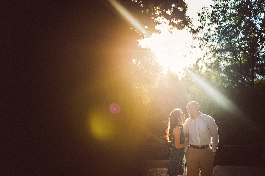 sun flare in engagement photo portraits