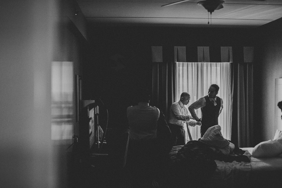 groom getting ready in hotel