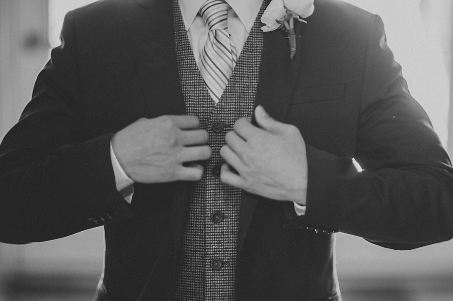 black and white of grooms suit
