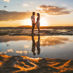 bride and groom at sunrise on australian coast