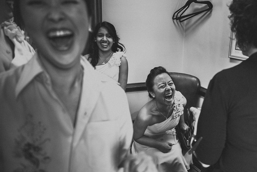 a photo of bridesmiads laughing