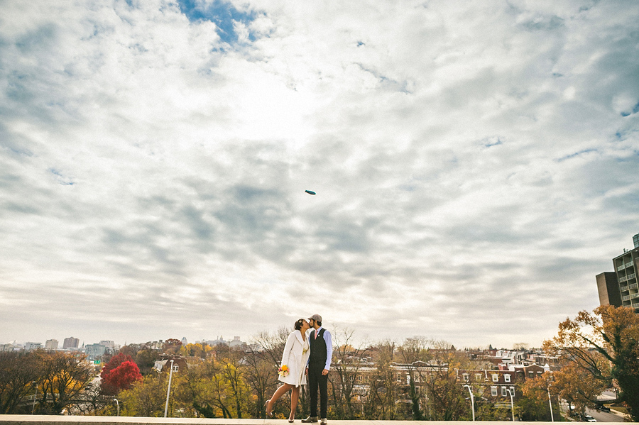 awesome photo of bride and groom on their wedding day in front of downtown baltimore maryland