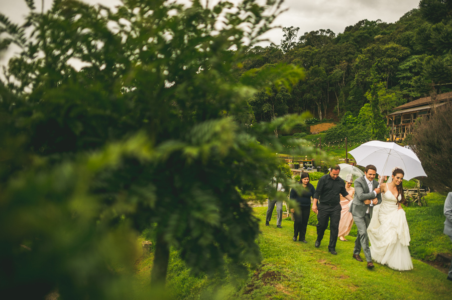 bride and groom walking to outdoor ceremony