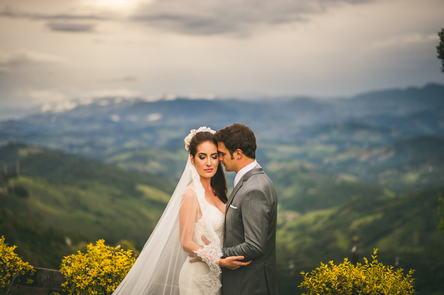 bride and groom on mountain side portrait
