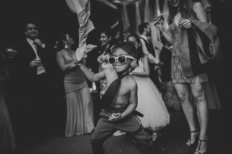 kid dancing crazy during wedding reception