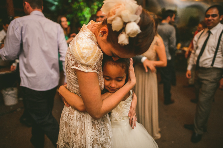 bride hugging flower girl