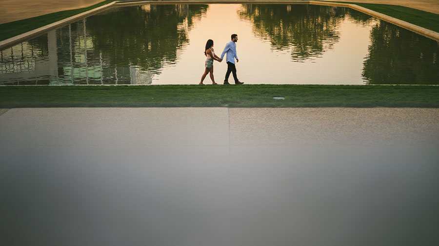 walking along a reflective pool