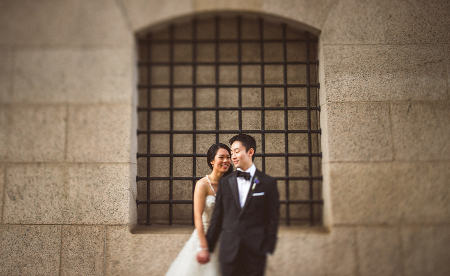 bride and groom in front of walters museum
