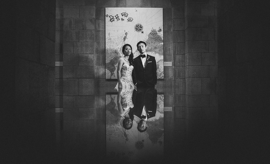 dramatic black and white portrait of bride and groom together