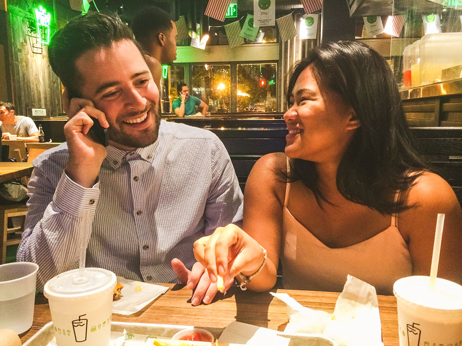 iphone photo of couple calling their mom to announce their engagement