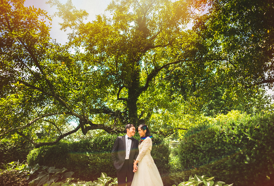 creative wedding portrait with sun flare