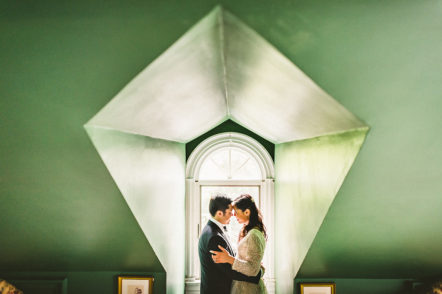 bride and groom portrait in an old attic