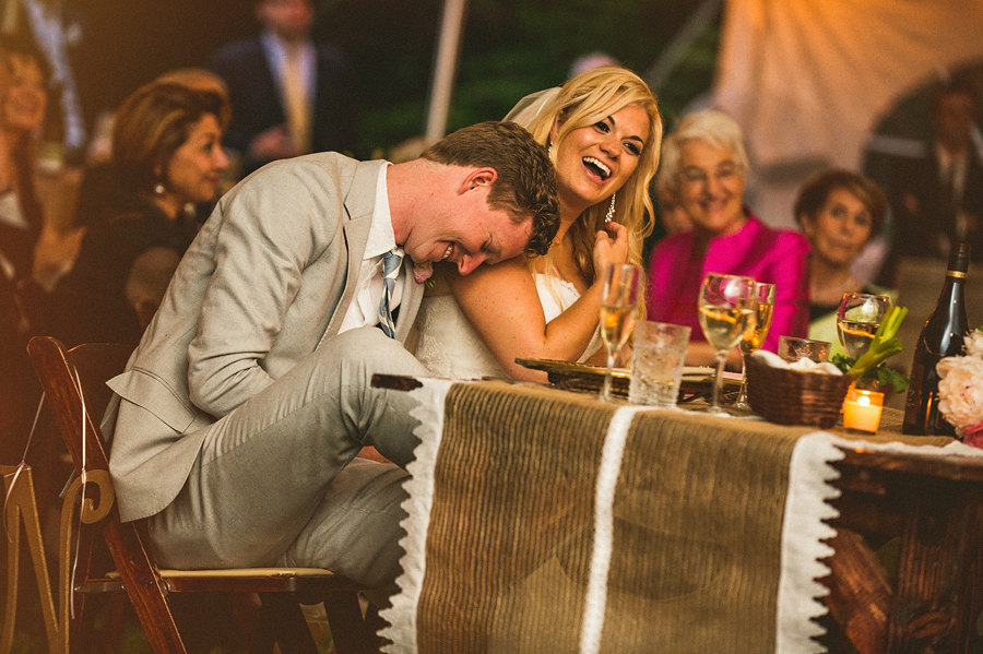 reception photos of bride and froom laughing