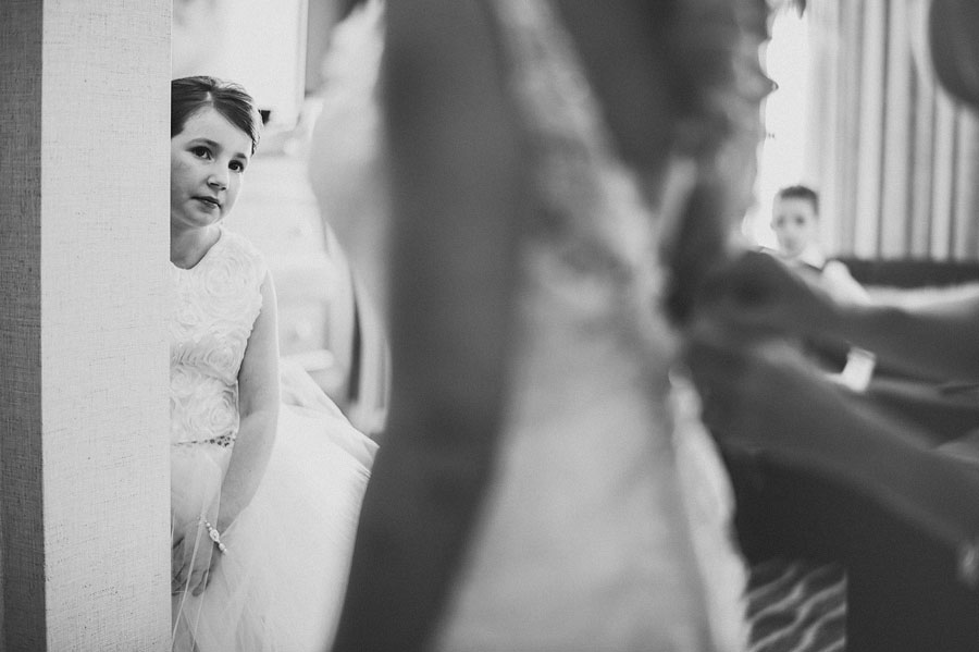 girl watching bride get ready