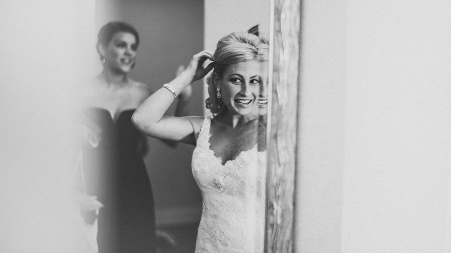 bride checking herself in the mirror