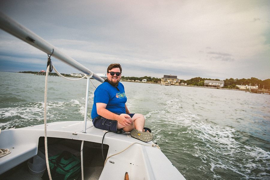 rob sitting on the back of his sailboat