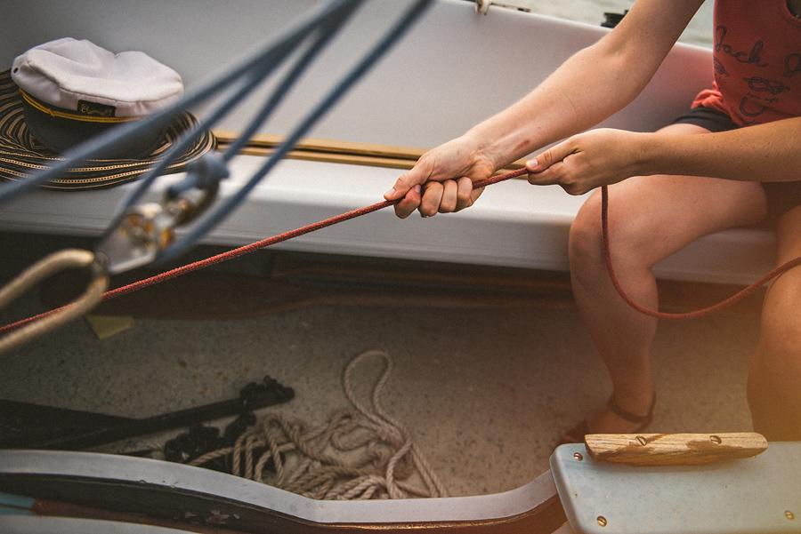 pulling ropes while sailing