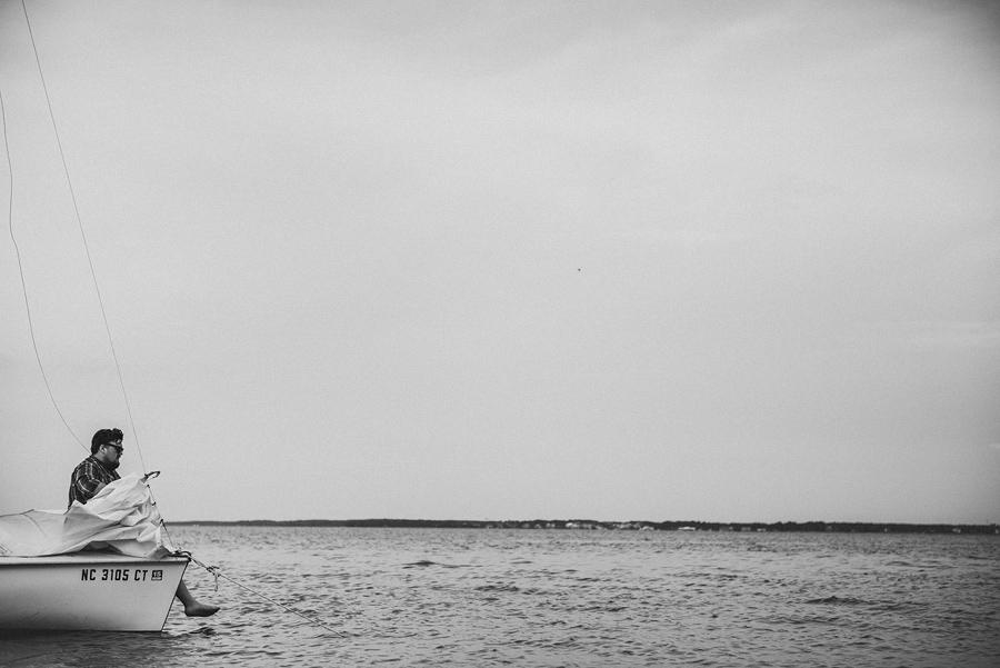 rob sitting on his sailboat