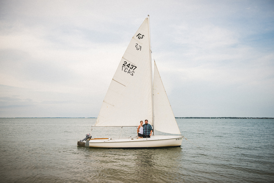couple in their sailboat