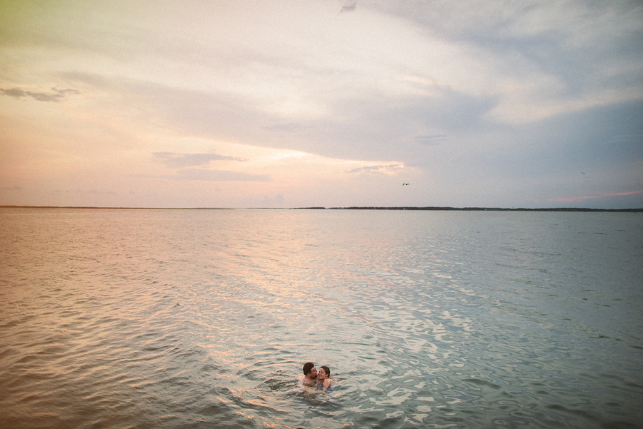 laura and rob swimming in the ocean