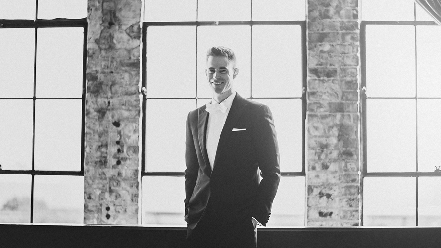 artistic black and white of groom on his wedding day