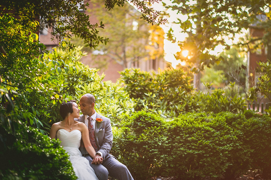 couple sitting outdoors together at sunset