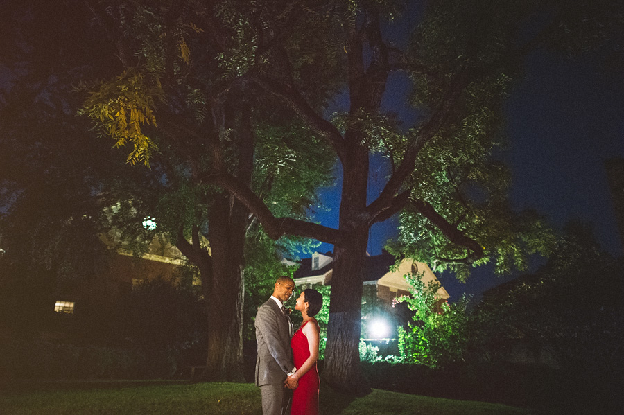 night portrait of bride and groom in back yard of lee fendall house