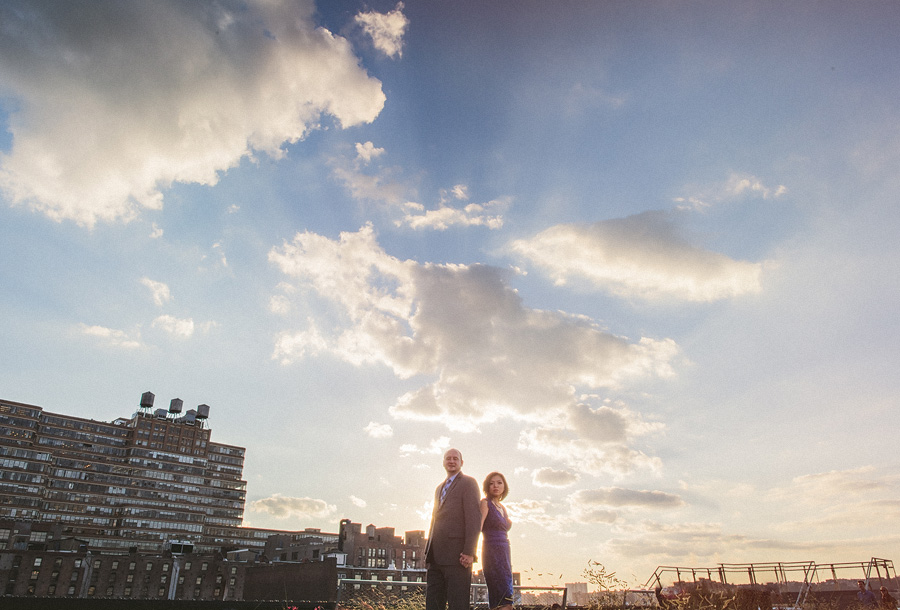 man and woman with awesome cloud at sunset