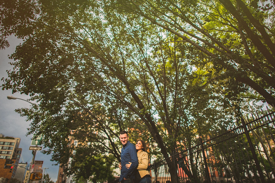 nyc wedding couple laughing in the street