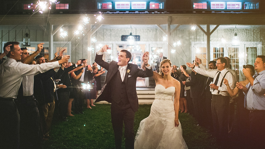 bride and groom exiting with sparklers at veritas winery