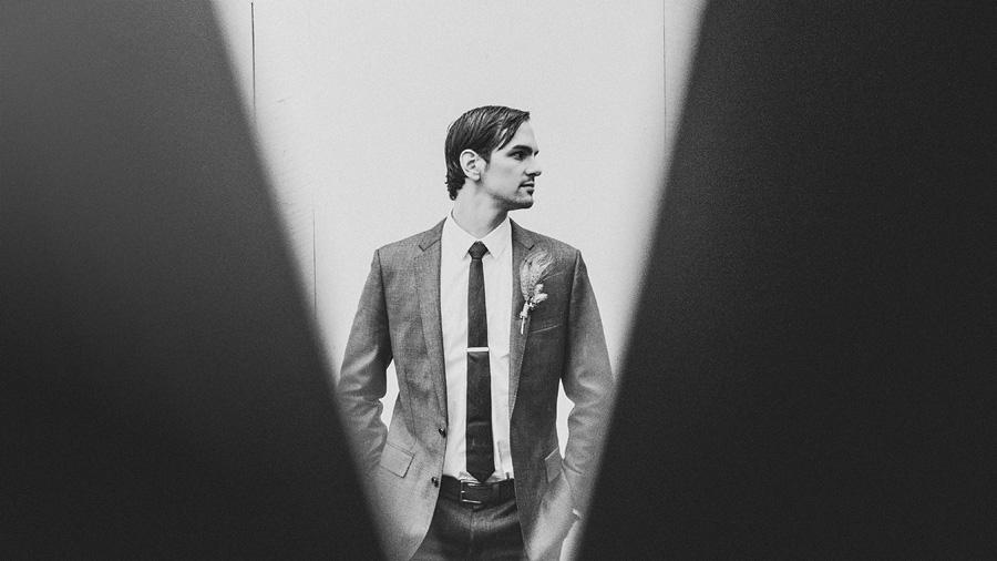 creative groom portrait on his wedding day