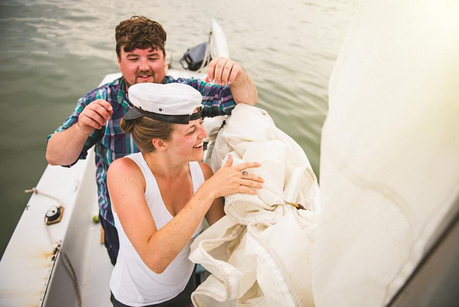 laura helping rob take down the sail