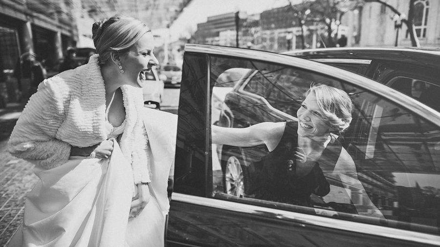 candid moment with bride getting into car in washington dc